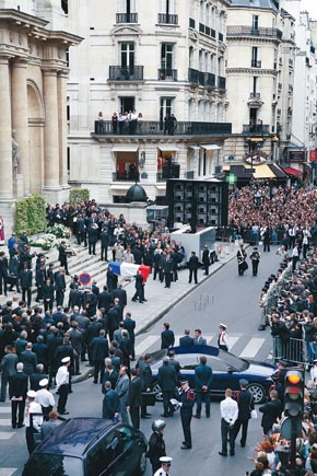Mourners outside the Saint-Roch church Thursday in Paris at the funeral of Yves Saint Laurent.