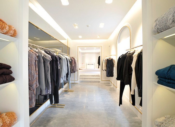 Folded knitwear and racks line the right flank of the Nina Ricci boutique on Avenue Montaigne.
