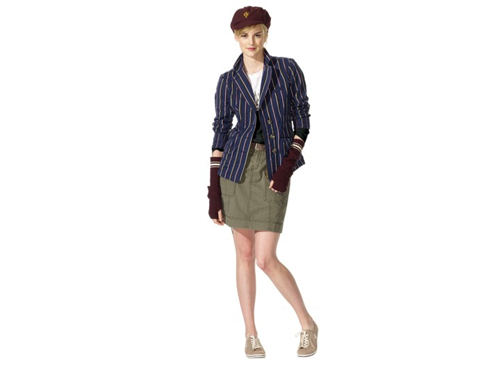A striped crewneck sweater is worn with pinstripe shorts, a pageboy cap and long ribbed gloves.