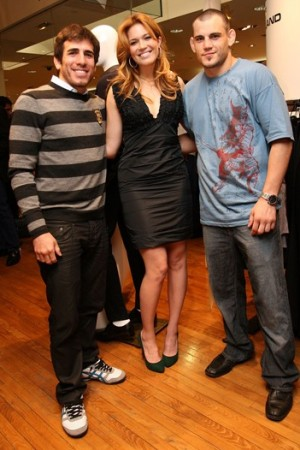Mandy Moore with ultimate fighters Rashad Evans and Dan Henderson at Barneys New York.
