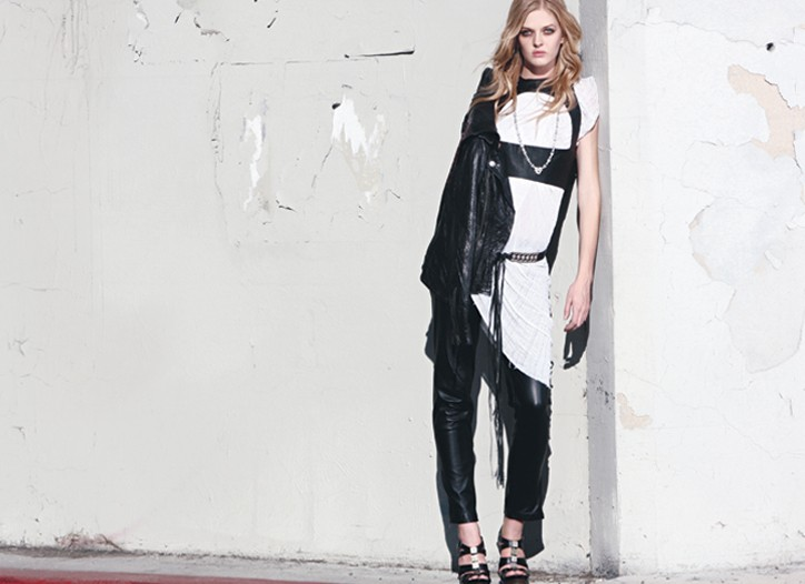 SMET by Christian Audigier's leather jacket over Raquel Allegra's recycled cotton shirt and Ina Soltani's leather vest and pants. Sandra Müller necklace; Streets Ahead belt; Charles David shoes.