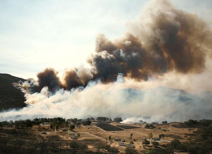 Flames burn across a ridge in San Diego County.