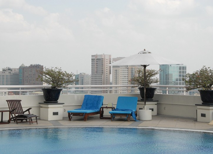 A skyline view from the pool at the Sofitel Plaza Hotel.