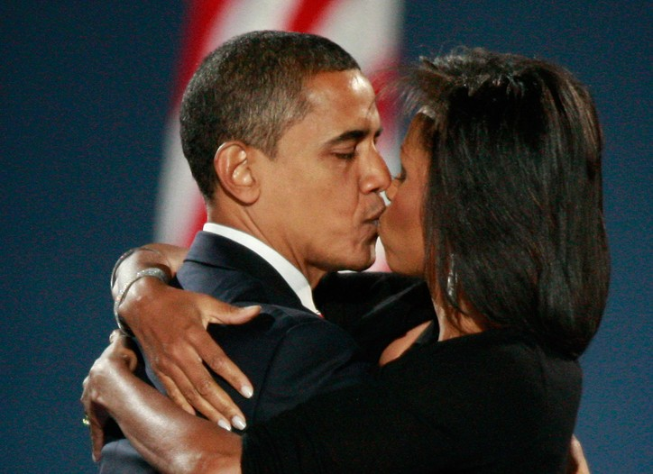 U.S. President elect Barack Obama kisses his wife Michelle after Obama gave his victory speech during an election night gathering in Grant Park on November 4, 2008 in Chicago, Illinois.