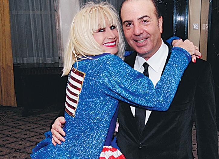 Betsey Johnson hugs Isaac S. Gindi.