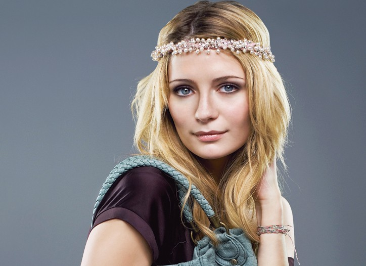 Mischa Barton wears her pearl and crystal headband and a Diesel dress, and holds her leather bag.