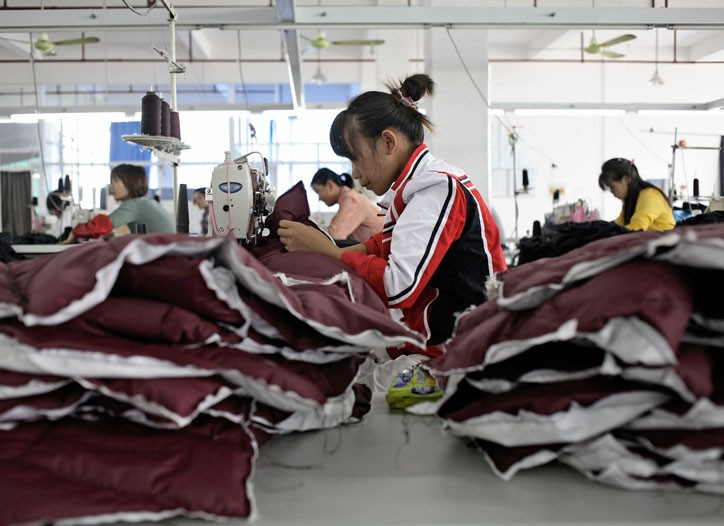 Workers manufacture down jackets at the Quanli Garment Factory in Pinghu, Zhejiang Province, China.