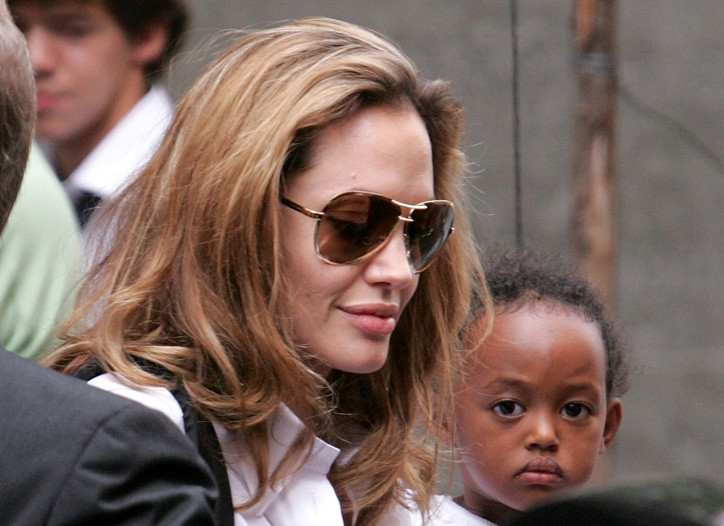 Angelina Jolie behind a pair of Guccis.