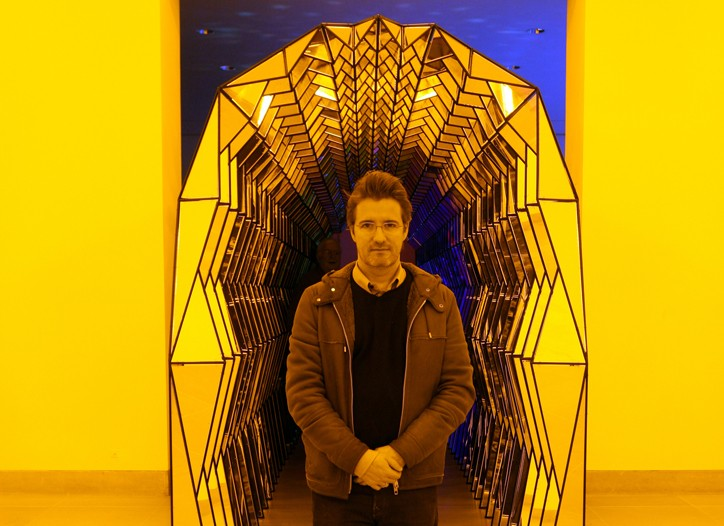 Olafur Eliasson in front of his yellow work.