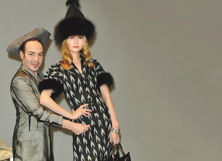 John Galliano and model