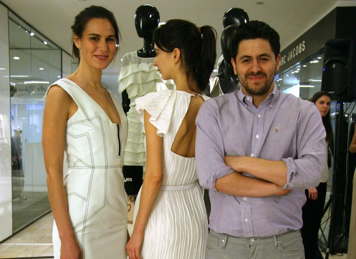 Brian Reyes with two models in his designs.