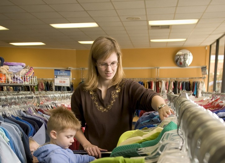 A shopper looks through clothing at a Goodwill store in Macon, Ga.