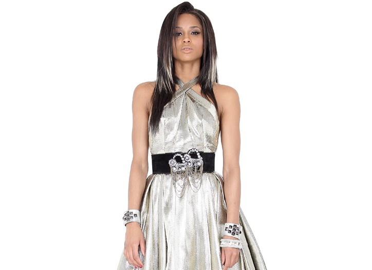 Rubin Singer's metal and silk lamé dress. Catherine Malandrino belt; bracelets by Alexis Bittar and Erickson Beamon; Hue tights and Christian Louboutin shoes.