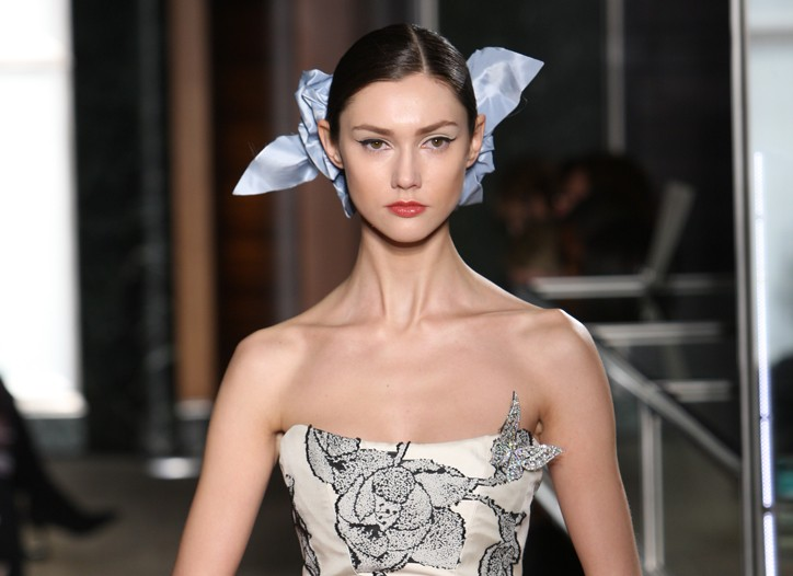 Carolina Herrera's unconventional ivory and black fils coupé gown — a nod to Edouard Manet — is accented by a Tiffany & Co. diamond and platinum butterfly brooch.