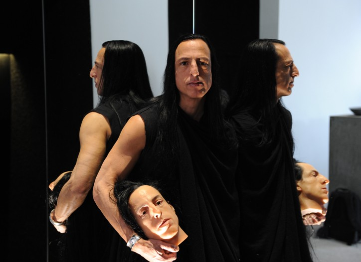 Rick Owens carries the wax model of his head that will be displayed in the London store.