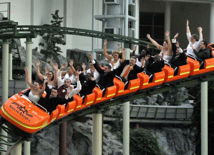 Fifteen wedding parties celebrated their respective nuptials at the Mall of America's amusement park.