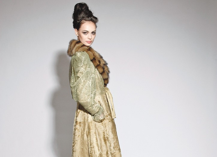 A lamb coat with a fitch collar and lace.