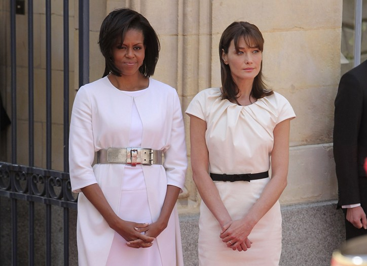 Michelle Obama in Narciso Rodriguez  and Michael Kors with Carla Bruni-Sarkozy in Christian Dior.