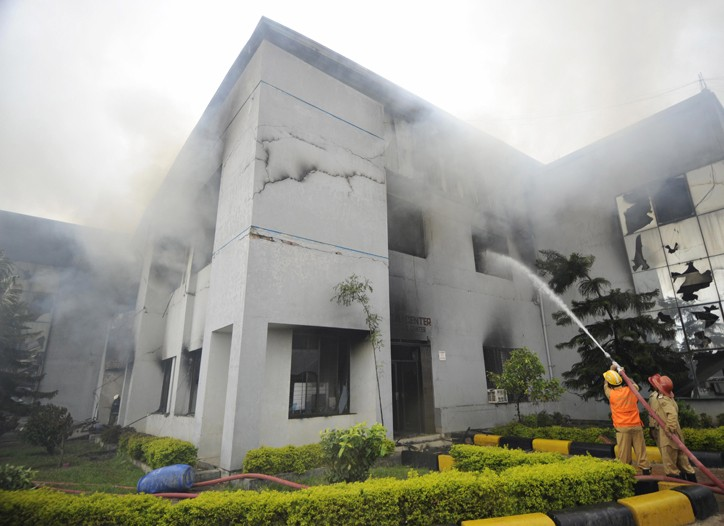 Bangladeshi firefighters extinguish a blaze at a garment factory in the Ashulia industrial zone.