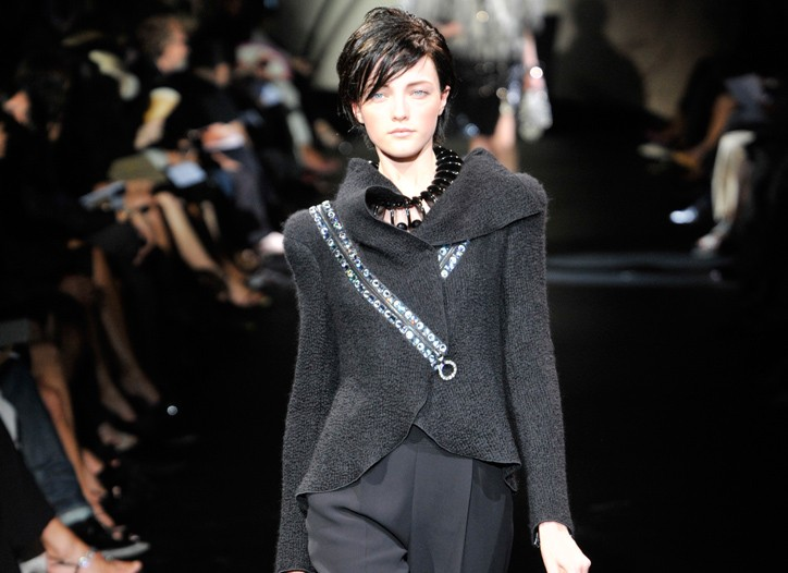 Giorgio Armani injected Eighties glam into a soft tailored wool version with a jeweled zipper for Giorgio Armani Privé.