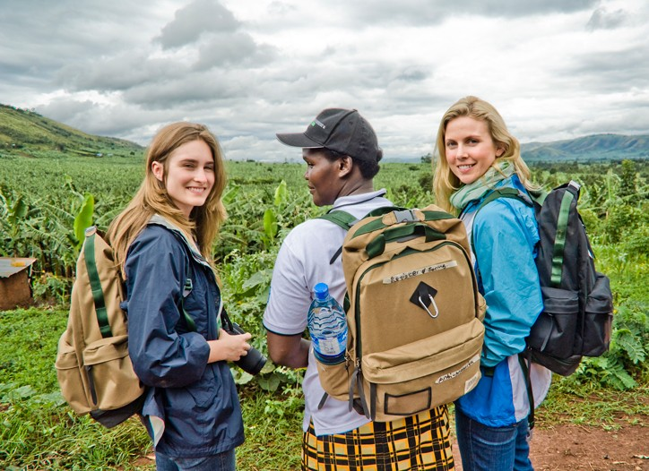 Feed Projects co-founders Lauren Bush and Ellen Gustafson with a Millennium Villages community health worker wearing the new backpacks in Uganda.