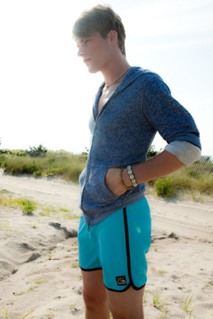 Quiksilver's polyester swimsuit and cotton sweater. Giles & Brother bracelet.