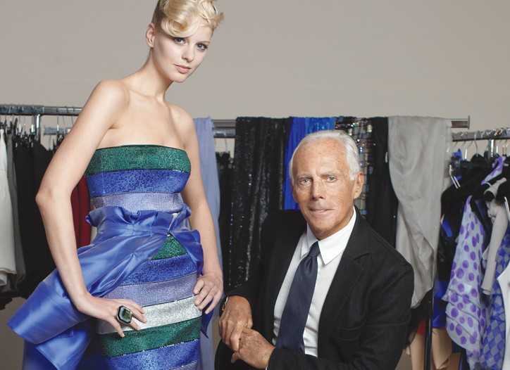 Giorgio Armani in his atelier with a model in a sparkling, strapless dress and skirt for spring.
