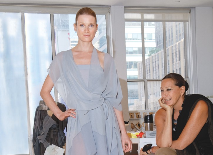 Donna Karan — pin cushion on her wrist — is at work in her Garment District studio, draping, tucking, chatting and casting.