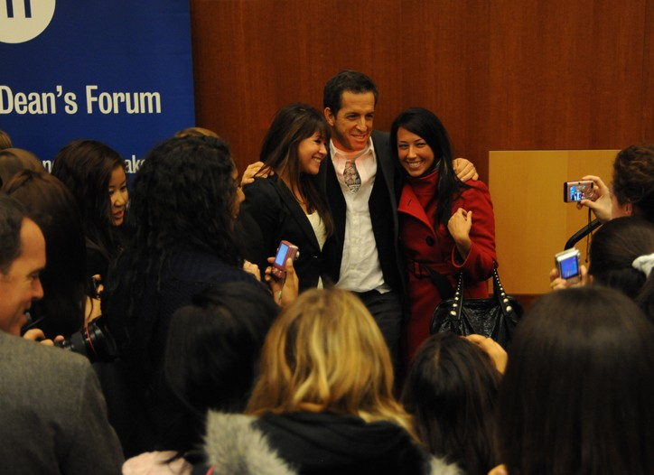 Kenneth Cole poses with students at F.I.T.