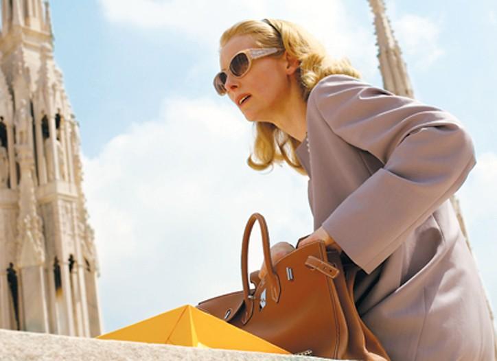 "Tilda Swinton wearing a Jil Sander coat and an Hermès bag in ""Io sono l'amore."""
