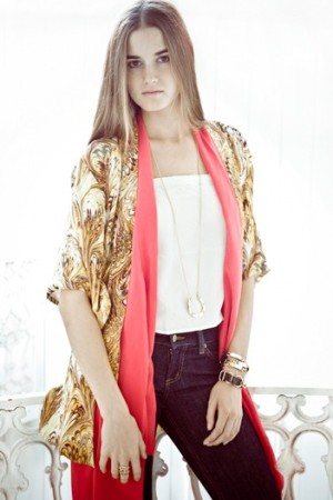 A Winter Kate jacket layered over a camisole and vest with House of Harlow 1960 accessories.