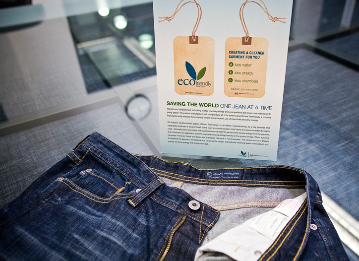 AG Adriano Goldschmied jeans treated with ozone technology and a display explaining the eco-friendly process.