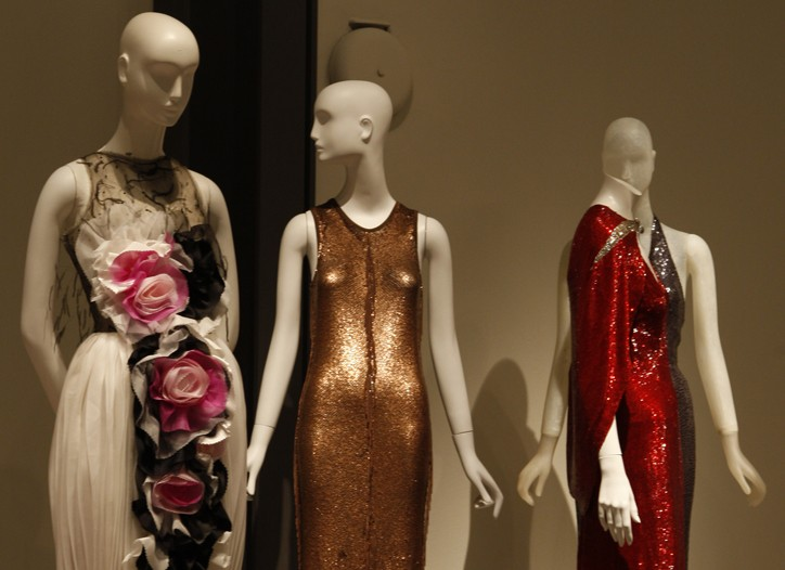 """Dresses from Rodarte, Narciso Rodriguez and Adrian's design for Joan Crawford on display at the """"American Beauty: Aesthetics and Innovation in Fashion"""" show."""
