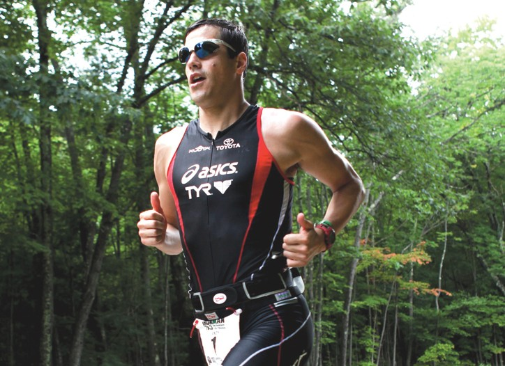 Triathlete Andy Potts races in compression socks.