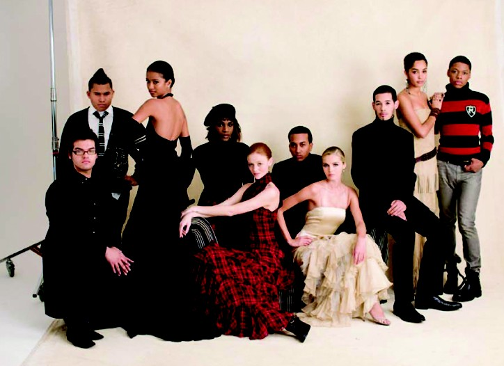 Students of the Harvey Milk School with the four gowns created at the Polo Fashion School.