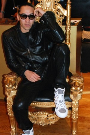 Taboo wearing one of his designs.
