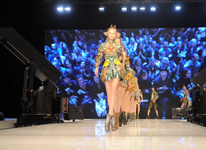 Alexander McQueen's runway with a live-streaming video backdrop.