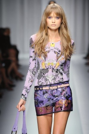 """Donatella Versace went archival sexy in a feisty, flashy collection with a nod to Tim Burton's """"Alice in Wonderland."""""""