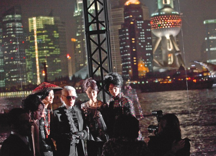 Karl Lagerfeld with models at Chanel's Shanghai bash.