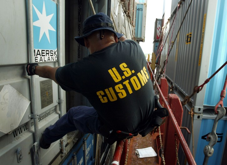 Customs agent inspects container