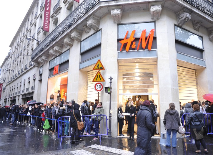 Shoppers lining up outside H&M in Paris for the Jimmy Choo collection.