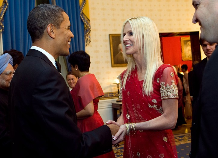 Michaela Salahi, greets President Obama at a state dinner for the Indian Prime Minister.