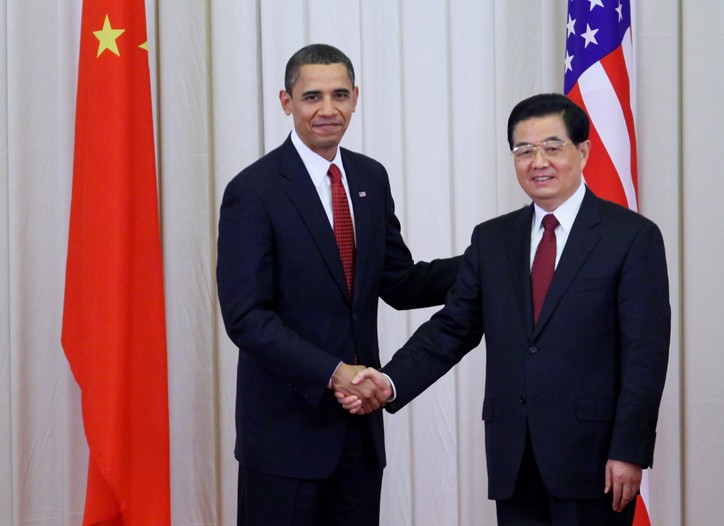 US President Barack Obama shakes hands with Chinese President Hu Jintao.