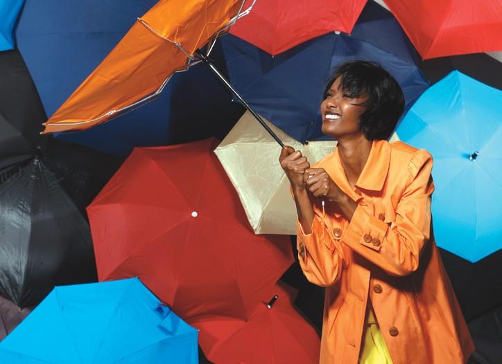 Weatherproof's cotton sateen coat over Matthew Ames' silk georgette dress. Hunter boots; Totes umbrellas.