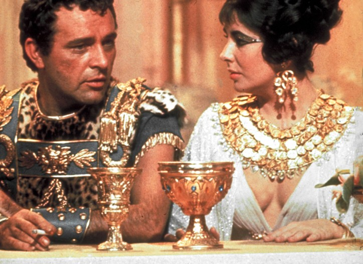 "Richard Burton and Elizabeth Taylor on set during the filming of ""Cleopatra,"" circa 1963."