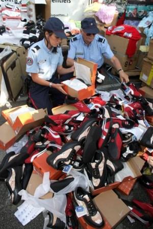 Customs officials sort through counterfeit goods.