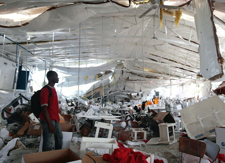 A worker looks over the devastation at the Palm Apparel T-shirt factory in Haiti.