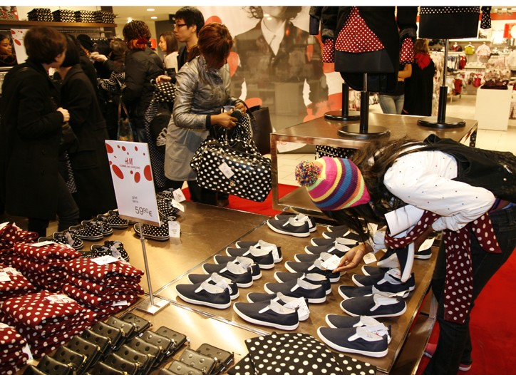 Shoppers browse the Comme des Garçons collection at an H&M store in France