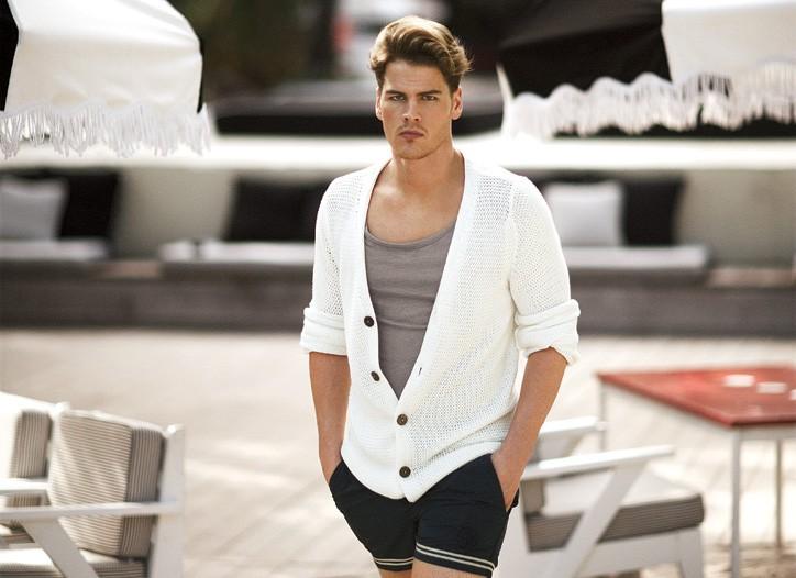 Christopher Fischer cotton and cashmere sweater; Oak cotton T-shirt; Stone Island cotton and nylon swim shorts.