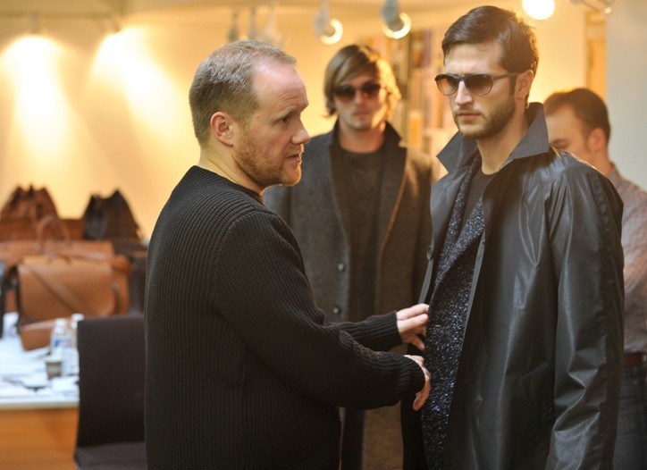 Paul Helbers, men's studio director under the artistic direction of Marc Jacobs at Louis Vuitton, puts the finishing touches on a dark ensemble.